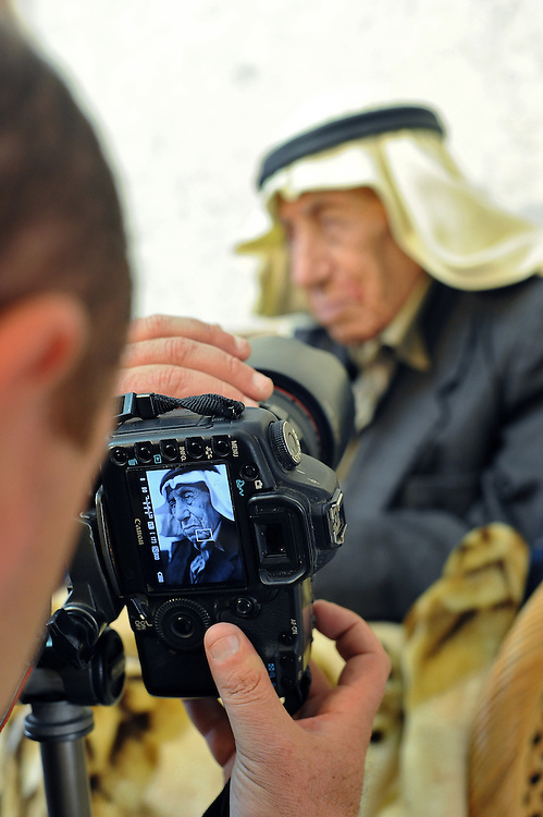 Photographer Amar Yunes collects a testimony from an old man at the Arab village of Muawiya, northern Israel.<br />