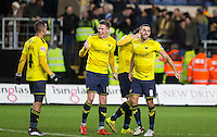 Oxford United players celebrate reaching the Wembley Cup Final during the Johnstone's Paint Trophy Southern Final 2nd Leg match between Oxford United and Millwall at the Kassam Stadium, Oxford, England on 2 February 2016. Photo by Andy Rowland / PRiME Media Images.