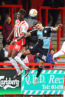Armand Gnanduillet of Stevenage and Matt Bloomfield of Wycombe Wanderers in action during the Sky Bet League 2 match between Stevenage and Wycombe Wanderers at the Lamex Stadium, Stevenage, England on 17 October 2015. Photo by PRiME Media Images.