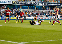 Millwall's James Meredith is felled in the box during the Sky Bet Championship match between Millwall and Ipswich Town at The Den, London, England on 15 August 2017. Photo by Carlton Myrie.