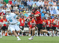 Baltimore, MD - April 28, 2018: Maryland Terrapins Austin Henningsen (17) runs with the ball during game between John Hopkins and Maryland at  Homewood Field in Baltimore, MD.  (Photo by Elliott Brown/Media Images International)