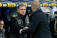 03.01.2012. Copa del Rey 1/4 The match played between  Real Madrid and Barcelona C.F. (1-2)  played at the Santiago Bernabeu Stadium.  Picture show Jose Mourinho  coach of Real Madrid and Josep Guardiola coach of F.C. Barcelona