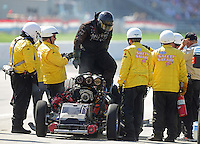 Sept 9, 2012; Clermont, IN, USA: NHRA safety safari crews tend to funny car driver Todd Lesenko as he climbs from his car after blowing the body off his car in a fiery explosion during the US Nationals at Lucas Oil Raceway. Mandatory Credit: Mark J. Rebilas-