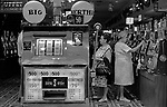 One armed bandits arcade slot machines, women playing  gambling. Big Bertha a giant one arm bandit in a Penny Arcade. 1969, Reno Nevada Casio. USA