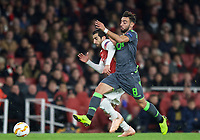 Henrikh Mkhitaryan of Arsenal & Bruno Fernandes of Sporting CP during the UEFA Europa League group match between Arsenal and Sporting Clube de Portugal at the Emirates Stadium, London, England on 8 November 2018. Photo by Andrew Aleks / PRiME Media Images.<br /> .<br /> (Photograph May Only Be Used For Newspaper And/Or Magazine Editorial Purposes. www.football-dataco.com)