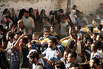 Palestinians carry the body of boys from the Baker family, whom medics said were killed with other two children from the same family by a shell fired by an Israeli naval gunboat, during their funeral in Gaza City July 16, 2014. Four Palestinian children were killed and one was critically wounded on a Gaza beach on Wednesday by the shell fired by the Israeli naval gunboat, a Palestinian health official said. Asked about the incident, an Israeli military spokesman in Tel Aviv said he was checking the report. Gaza health officials said 207 Palestinians, most of them civilians, had been killed in air and naval barrages, in the worst flareup of Israeli-Palestinian violence in two years. One Israeli has been killed by shelling from Gaza that has made a race to shelter a daily routine for hundreds of thousands in Israel. Photo by Ali Jadallah