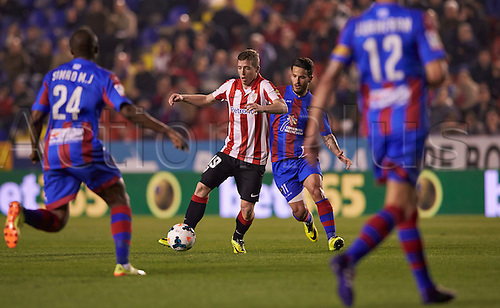 07.04.2014 Valencia, Spain. Forward Iker Muniain of Athletic Bilbao (C) is challenged by Midfielder Simao MJ of Levante U.D. (L) and Forward Ruben G. of Levante U.D. during the La Liga game Levante UD v Athletic Bilbao at Ciutat de Valencia Stadium, Valencia.