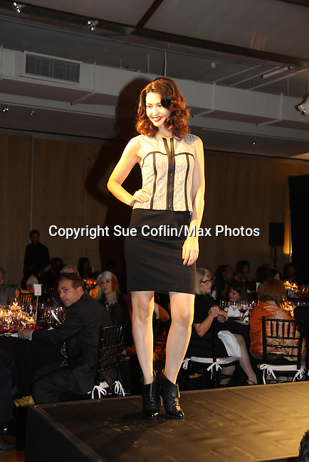 """Fashion Show at The Fourteenth Annual Hearts of Gold Gala """"Hooray for Hollywood!"""" - with its mission to foster sustainable change in lifestyle and levels of self-sufficiency for homeless mothers and their children on October 28, 2010 at the Metropolitan Pavillion, New York City, New York. (Photo by Sue Coflin/Max Photos)"""