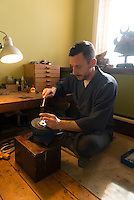 Soanes works on the hanchimaza, a metal piece at the top of the kabuto. Robert Soanes Japanese Armour and Antiques Restorer, Brighton, UK, May 6, 2016. Craftsman Robert Soanes specializes in the restoration and conservation of samurai armour, swords and other Japanese fine art. He lives and works in the English seaside resort of Brighton.