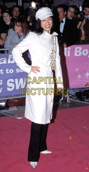 VANESSA MAE.Down With Love premiere, Odeon Kensington.full length, full-length, white trench coat, hand on hip, baker boy cap, hat.www.capitalpictures.com.sales@capitalpictures.com.© Capital Pictures.