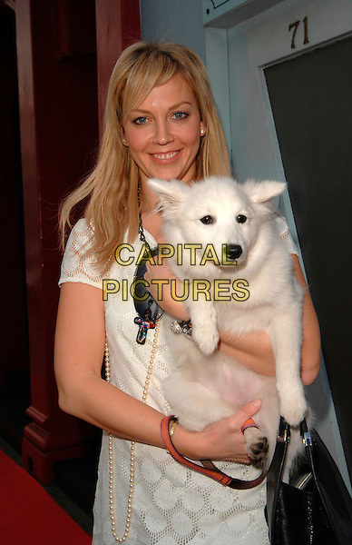 LIZ FULLER .At the Andrex Puppy Red Nose Day Charity Lunch and Auction, The Clerkenwell, London, England, .February 26th 2007..half length dog pet white dress.CAP/CAN.©Can Nguyen/Capital Pictures