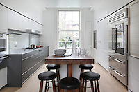The modern Buthaup kitchen made of aluminium Gray and Alpine White matt lacquer cabinetry in the home of designer Kate Groes