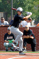 First baseman Ryan Ripken #20 of Gilman High School bats in the home run derby as his father, Hall of Fame shortstop Cal Ripken Jr, looks on with Sammy Serrano of USA Baseball during practice for the Under Armour All-American Game presented by Baseball Factory at Les Miller Field on August 12, 2011 in Chicago, Illinois.  (Mike Janes/Four Seam Images)