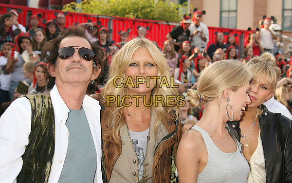 """KEITH RICHARDS, PATTI HANSEN, THEODORA RICHARDS & ALEXANDRA RICHARDS.""""Pirates Of The Caribbean: At World's End"""" World Premiere held at Disneyland, Anaheim, California, USA,.May 19th, 007.3 half length daughters father family mustache facial hair aviator sunglasses shades married husband wife hoop earrings.CAP/ADM/RE.©Russ Elliot/AdMedia/Capital Pictures"""