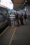 Passengers boarding train from platform Ipswich Suffolk England