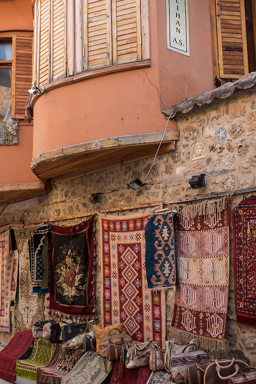 In Antalya, a side street shop bristles with a variety of turkish carpets for sale.