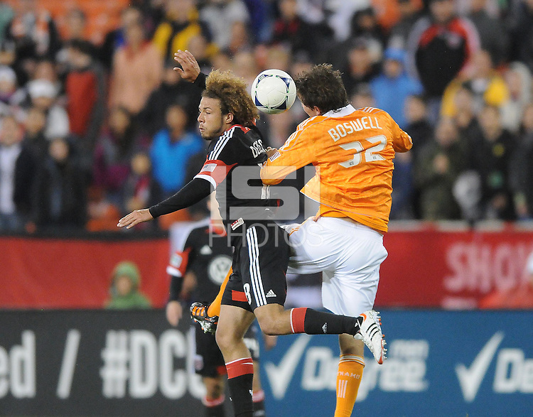 D.C. United midfielder Nick DeLeon (18) heads the ball against Houston Dynamo defender Bobby Boswell (32) D.C. United defeated The Houston Dynamo 3-2 at RFK Stadium, Saturday April 28, 2012.