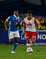 BOGOTA - COLOMBIA - 16 – 07 - 2017: Harold Mosquera (Izq.) jugador de Millonarios disputa el balón con Juan Daniel Roa (Der.) jugador de Independiente Santa Fe, durante partido de la fecha 2 entre Millonarios y el Independiente Santa Fe, por la Liga Aguila II-2017, jugado en el estadio Nemesio Camacho El Campin de la ciudad de Bogota. / Harold Mosquera (L) player of Millonarios vies for the ball with Juan Daniel Roa (R) player of Independiente Santa Fe, during a match of the date 2nd between Millonarios and Independiente Santa Fe, for the Liga Aguila II-2017 played at the Nemesio Camacho El Campin Stadium in Bogota city, Photo: VizzorImage / Luis Ramirez / Staff.
