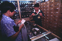 SELLING CHINESE HERBAL MEDICINE TO MAKE A BAY BOY AT A CHINESE MEDICINE SHOP IN GUANGZHOU, CHINA.  <br /> &copy;sinopix