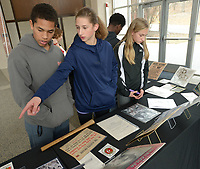 NWA Democrat-Gazette/ANDY SHUPE<br /> Asa Poole (from left), 12; Meg Gebhart, 12; and Kennedy Phelan, 13; all seventh-graders at Ramay Junior High School in Fayetteville, look Friday, Feb. 9, 2018, at artifacts on display while visiting the Black History 101 Mobile Museum inside the Janelle Y. Hembree Alumni House on the University of Arkansas campus in Fayetteville. A selection of 200 items from a collection of more than 7,000 artifacts from black history in the U.S. was hosted by the Sam M. Walton College of Business Office of Diversity and Inclusion and The Visionairi Foundation.