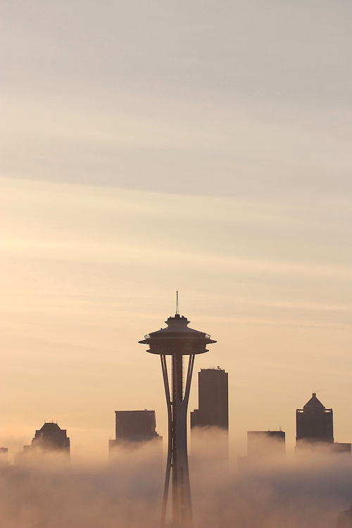 Seattle Space Needle silhouetted with fog at sunrise, Washington State, Pacific Northwest,.