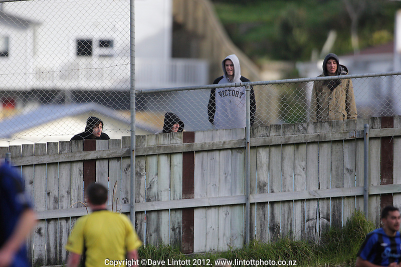 Fans watch over the fence during the Chatham Cup football match between  Miramar Rangers and Dunedin Technical at David Farrington Park, Wellington, New Zealand on Sunday, 22 July 2012. Photo: Dave Lintott / lintottphoto.co.nz