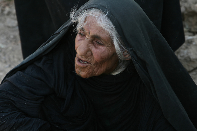 An old woman waits to be searched before receiving food and water from U.S. and Iraqi soldiers in Baqubah, Iraq, where coalition forces have launched a large-scale offensive to clear insurgents from the city.   For the past four days, they have been distributing emergency  food and water to residents trapped in the fighting. June 24, 2007. DREW BROWN/STARS AND STRIPES