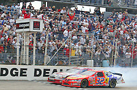 Ricky Craven (#32) beats Kurt Busch to the finish line to win the Dodge Dealers 400 in the closest finish in NASCAR history at Darlington Raceway, Darlington , SC, March 16, 2003. (Photo by Brian Cleary/www.bcpix.com)