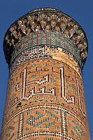 Detail of one of the corner minarets, main gate, Bibi-Khanym Mosque, 15th century,  Samarkand, Uzbekistan, pictured on July 17, 2010, in the afternoon. Named after the wife of Amir Timur, 14th century ruler, the mosque was constructed following his 1399 Indian campaign. It collapsed after an earthquake in 1897 and was restored in the late 20th century. Samarkand, a city on the Silk Road, founded as Afrosiab in the 7th century BC, is a meeting point for the world's cultures. Its most important development was in the Timurid period, 14th to 15th centuries. Picture by Manuel Cohen.