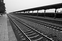 Daytime horizontal view from a train of train tracks at a train station near Píngyáo county of the Jìnzhōng district in Shānxī Province, China  © LAN