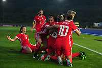 Kayleigh Green of Wales Women's' is mobbed by team mates as they celebrates the opening goal during the Women's International Friendly match between Wales and New Zealand at the Cardiff International Sports Stadium in Cardiff, Wales, UK. Tuesday 04 June, 2019