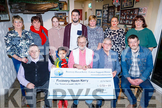 Eamon Kirby of Kirby's Bar Ardfert presenting the sum of €5,150:00 to Dermot Crowley of Recovery Haven on Friday night in the bar, from the recent Movember fundraiser. <br /> Front l to r: Joe Egan, Eamon and Eamon Kirby, Dermot Crowley and Declan O'Connor.<br /> Back l to r: Olivia Murphy, Brenda and Nicole O'Connor, David O'Mahoney, Mairead Kirby, Elaine Casey and Helen Geary.