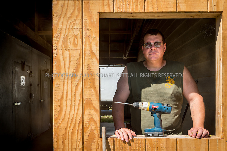 8/12/2016-- Mount Vernon, WA, USA<br /> <br /> Staff from the Schultz Family Foundation visit the Growing Veterans farm in Mt. Vernon, Washington, about an hour north of Seattle.<br /> <br /> <br /> Here, veteran Andrew Meyer, 41, works on the farm.<br /> <br /> From http://growingveterans.org:<br /> <br /> &ldquo;Since 2012, Growing Veterans has been combining veteran reintegration with sustainable agriculture. Our unique model addresses the growing desire for alternative therapies for Post-Traumatic Stress (PTS) and Traumatic Brain Injury (TBI), as well as suicide prevention through peer-support and Applied Suicide Intervention Skills Training (ASIST) certification. We encourage continued service through volunteerism, and collective impact through collaboration with other local, regional, and national stakeholders.&nbsp; We provide opportunities for vets in transition to develop their resumes and identify how to translate skills learned in the military to new roles in the civilian sector. Further, our vets serve as leaders in the important movement toward sustainable agriculture&rdquo;<br /> <br /> Photograph by Stuart Isett. &copy;2016 Stuart Isett. All rights reserved.