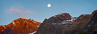 Super moon rising above Darran Mountains in Milford Sound at sunset, Fiordland National Park, UNESCO World Heritage Area, Southland, New Zealand, NZ