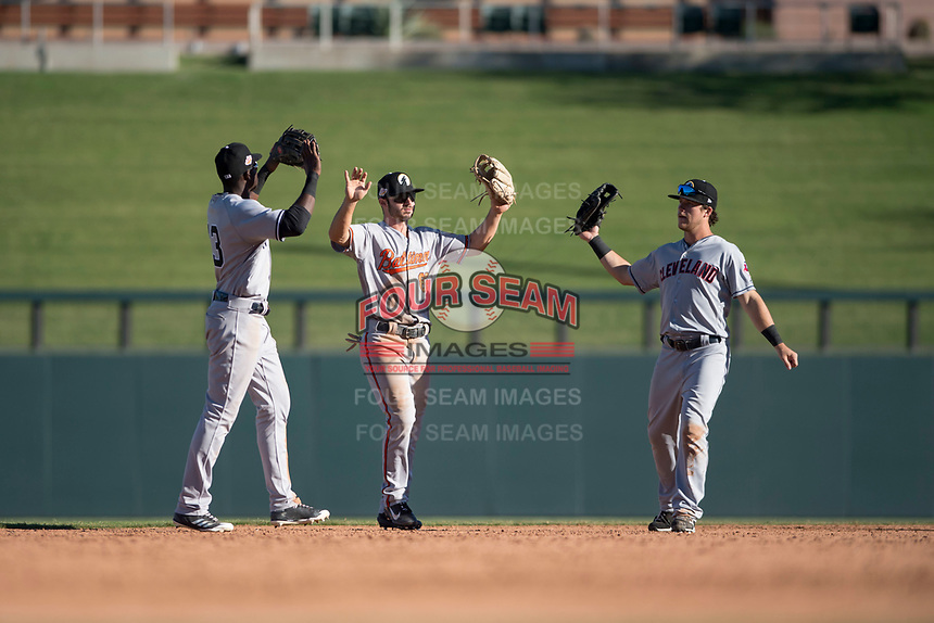 Glendale Desert Dogs outfielders Estevan Florial (13), Ryan McKenna (82), and Connor Marabell (4) celebrate a victory after an Arizona Fall League game against the Salt River Rafters at Salt River Fields at Talking Stick on October 31, 2018 in Scottsdale, Arizona. Glendale defeated Salt River 12-6 in extra innings. (Zachary Lucy/Four Seam Images)