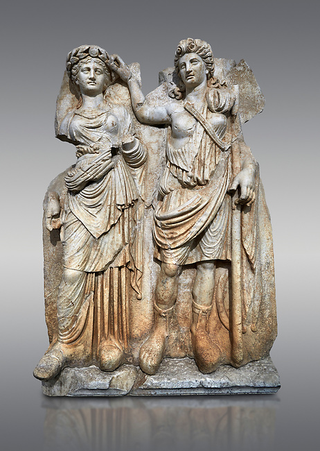 Roman Sebasteion relief  sculpture of Aphrodite crowned by Andreia, Aphrodisias Museum, Aphrodisias, Turkey. <br /> <br /> A draped goddess is crowned by a female warrior figure. The goddess is probably Aphrodite, while the warrior has a bare breated Amazonian dress and equipment (spear, sword strap and shield) worn by Roma or Andreia (Bravery)