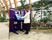 Woman using the online voting & information booth in the Winter Gardens, Sheffield, South Yorkshire