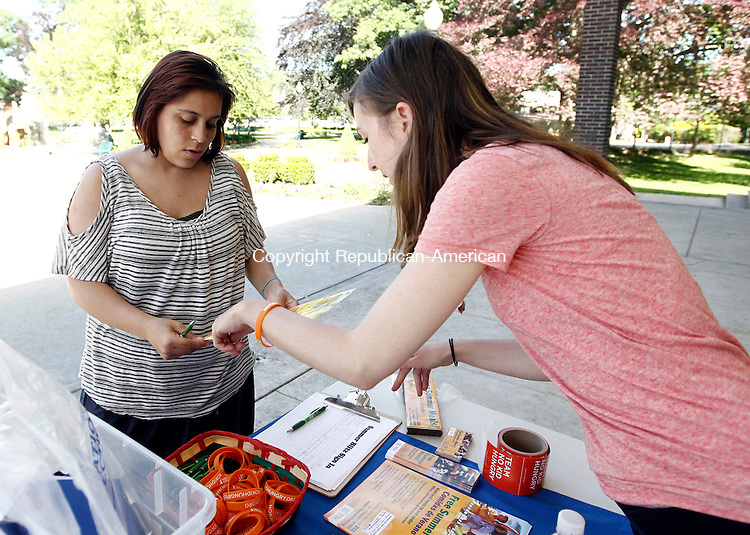 Torrington, CT- 16 June 2014-061614CM02-  Genevieve Caron, right, Child Nutrition Coordinator, talks with Sabrina Delvalle of Philadelphia, PA at Coe Memorial Park in Torrington on Monday.  Education Connection, in collaboration with End Hunger Connecticut!, CT Action for Healthy Kids (AFHK) and The Connecticut No Kid Hungry campaign, hosted a Volunteer Blitz Day to kick off its free Summer Food Program.  In Torrington, every weekday from June 23 through August 15 all children ages 18 and under are invited to receive a free healthy meal at either Coe Park or Vogel-Wetmore School.   Christopher Massa Republican-American