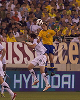 Brazil midfielder Lucas (5) and USA midfielder Sacha Kljestan (16) battle for head ball. Brazil  defeated the US men's national team, 2-0, in a friendly at Meadowlands Stadium on August 10, 2010.