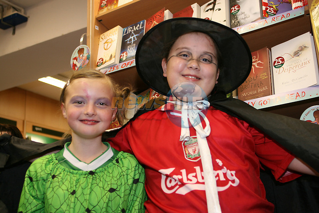 Siobhan Swift and Chloe Leech show off their outfits as they queue for the new Harry Potter book...Photo NEWSFILE/Jenny Matthews.(Photo credit should read Jenny Matthews/NEWSFILE)....This Picture has been sent you under the condtions enclosed by:.Newsfile Ltd..The Studio,.Millmount Abbey,.Drogheda,.Co Meath..Ireland..Tel: +353(0)41-9871240.Fax: +353(0)41-9871260.GSM: +353(0)86-2500958.email: pictures@newsfile.ie.www.newsfile.ie.FTP: 193.120.102.198.