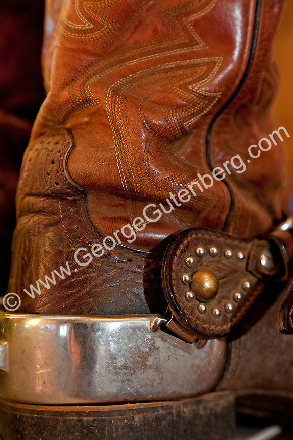 Detail of used cowboy boot with spur