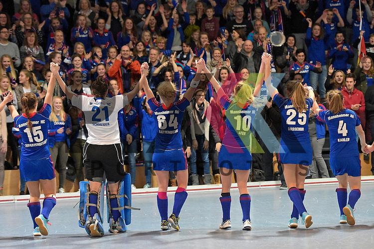 GER - Mannheim, Germany, January 30: During the 1. Bundesliga Damen indoor hockey quarter final match between Mannheimer HC (blue) and TuS Lichterfelde (black) on January 30, 2016 at Irma-Roechling-Halle in Mannheim, Germany.   Mannheimer HC celebrates after winning 2-1<br /> <br /> Foto &copy; PIX-Sportfotos *** Foto ist honorarpflichtig! *** Auf Anfrage in hoeherer Qualitaet/Aufloesung. Belegexemplar erbeten. Veroeffentlichung ausschliesslich fuer journalistisch-publizistische Zwecke. For editorial use only.
