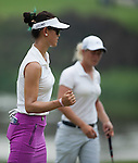 CHON BURI, THAILAND - FEBRUARY 16:  Michelle Wie of USA celebrates after a putt on the 8th green during day one of the LPGA Thailand at Siam Country Club on February 16, 2012 in Chon Buri, Thailand.  Photo by Victor Fraile / The Power of Sport Images