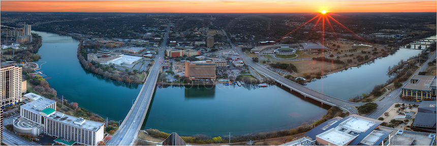 From 54 stories high, this is the view from such a loft perch on the edge of Austin, Texas. Below flows the calm waters of the Colorado River (in this stretch called Lady Bird Lake). The sun sets peacefully in the west.