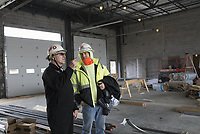 Assistant Chief Ron Skelton (from left) and Milestone Construction Company Superintendent Scott Sitton discuss construction details, Thursday, January 30, 2020 at the new Springdale Fire Department #8 in Springdale. Check out nwaonline.com/200131Daily/ for todayÕs photo gallery.<br /> (NWA Democrat-Gazette/Charlie Kaijo)<br /> <br /> The city has dedicated all of the money in the 2018 fire department bond. The bond budget included three new fire stations and an expansion of the departmentÕs training center.