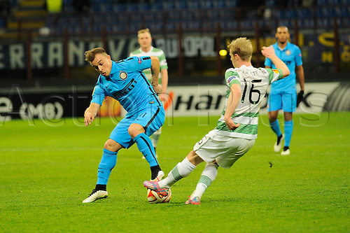 26.02.2015. Milan, Italy.  Xherdan Shaqiri of FC Inter and Gary Mackay-Steven of Celtic FC  in action during the Europa League soccer match between Inter Milan and Celtic FC at San Siro Stadium in Milan, Italy.
