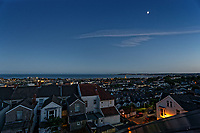 The moon seen in the sky over Swansea Bay in south Wales at 10.20pm during the summer solstice, the year's longest day. Thursday 21 June 2018