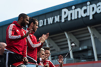 CARDIFF, UK. 8th July 2016. The Welsh football team are welcomed home with a public celebration event after reaching the semi-final of the Euro 2016 championship. After landing at Cardiff airport, an open-top bus parade took them through the city centre.<br /> <br /> L-R: Ashley Williams, Gareth Bale, Aaron Ramsey, Wayne Hennessey