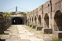 The second floor of the historic Fort Totten Water Battery in Fort Totten in the Bayside neighborhood of Queens in New York on Sunday, June 15, 2014. Construction on the historic fort started in 1862 on Willet's Point overlooking the East River into Long Island Sound.  The Throg's Neck Bridge is seen in the background.  (© Richard B. Levine)
