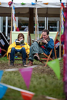 Thursday  29 May 2014, Hay on Wye, UK<br /> Pictured: People relax and read books at the Hay Festival <br /> Re: The Hay Festival, Hay on Wye, Powys, Wales UK.
